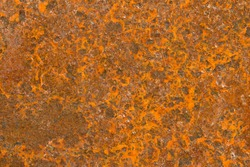 Brown Rust Textured Background. Abstract corroded colorful rusty metal background. rusty fiery red metal with spots, scratches and other damage.