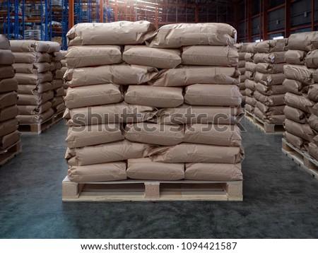 Brown sacks on wooden pallet store in industrial warehouse.
