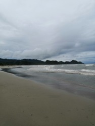 brown sand beach at dusk