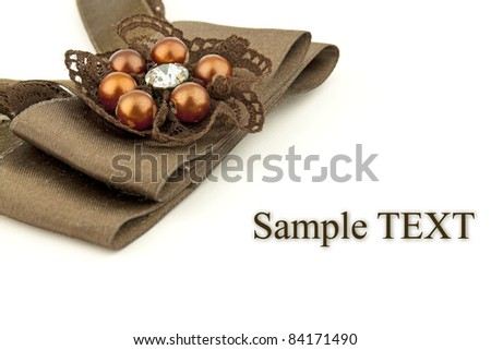 Brown satin gift bow isolated on white with space for text #84171490