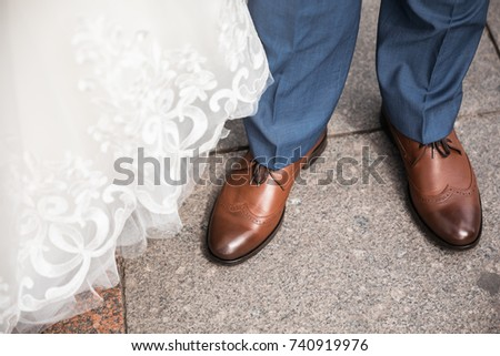 b2de92bd0d Brown shoes on male legs. The groom in a blue pants.  740919976