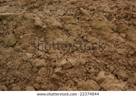 Brown soil, agricultural field background