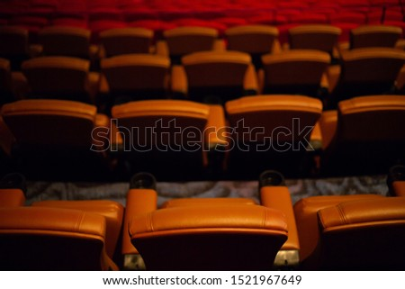 brown special leather seat in movie theater. pattern of many armchairs in dark room . #1521967649