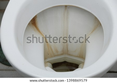 Brown stains in sanitary ware, Dirty sanitary ware in the toilet.