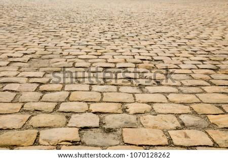 brown stone pavement #1070128262