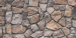 Brown stone wall texture, floor background. Wide panoramic rock pattern. Natural masonry surface, brick frame. Grunge structure. Design element.