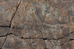 Brown stone with cracks on the surface
