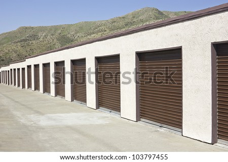 Brown storage units in a long strip row.