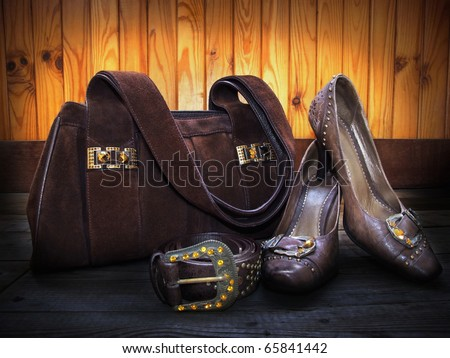 Brown suede bag, leather shoes and belt decorated by yellow and orange artificial gems