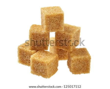 Brown sugar, a few pieces. Isolated on white.