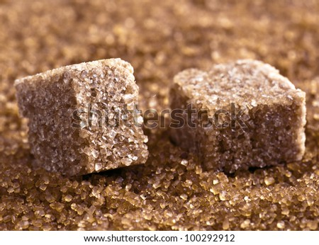 brown sugar cubes on powdered sugar