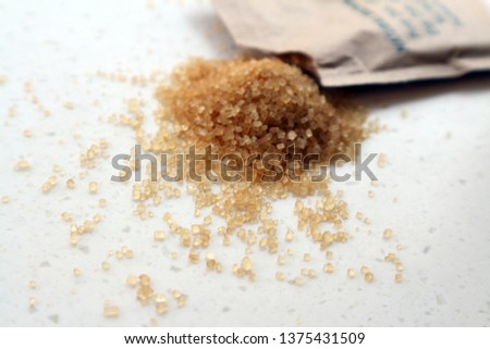Brown sugar granules.