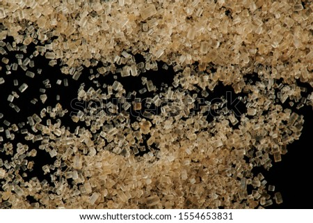 Brown sugar granules macro close up view
