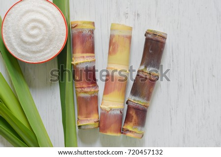 Brown sugar produced from sugar cane, top view, Agriculture Industry concept,white sugar on rustic wood table.