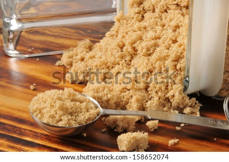 Brown sugar spilling out of a glass canister