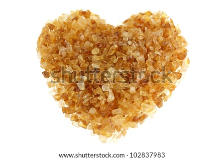 Brown sugar with a shape of heart, isolated on a white background