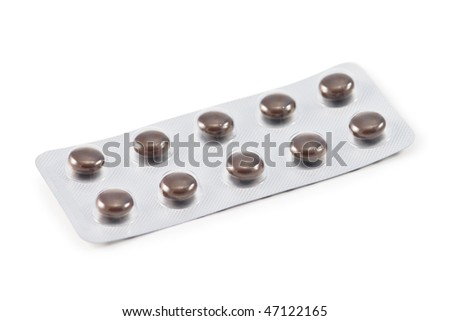 brown tablets on white background