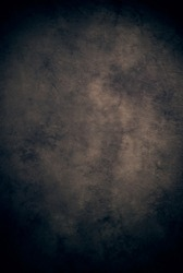 Brown tan black cloth fabric canvas or muslin studio background, darker edges and lighter center, neutral and traditional for portraiture, etc
