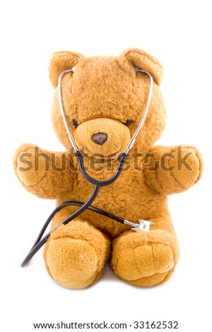 Brown teddybear acting as a doctor with a stetoscope isolated on white - stock photo