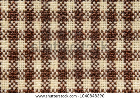 Brown textiles in a cage. Texture of cloth, close-up #1040848390