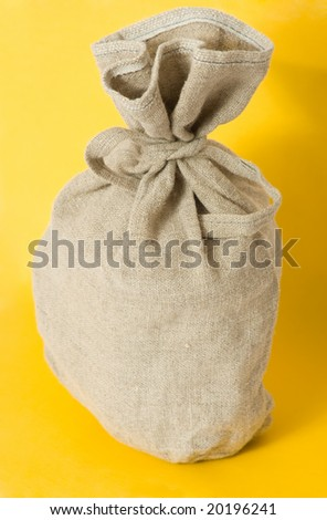 Brown textured sack on yellow background - stock photo