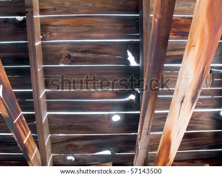 Brown textured wooden planks on an abandoned house