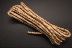 brown thick rope, rope on black background
