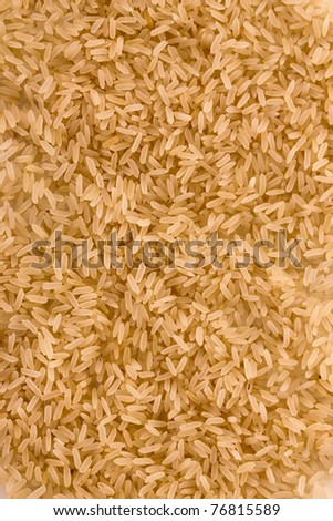 Brown uncoocked long rice as texture
