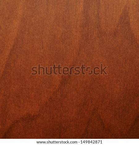 Brown varnished wood fragment as a background