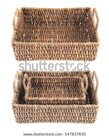 Brown wicker basket, box shaped, isolated over white background, set of two foreshortenings