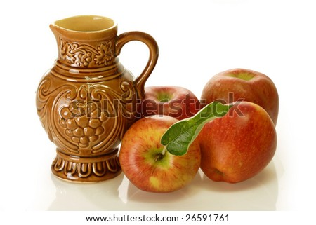 Brown wine jug with apples on bright background
