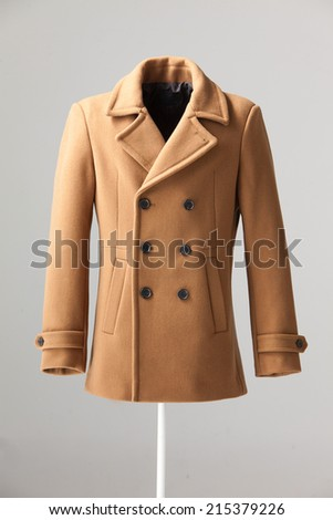 brown winter coat isolated on gray background
