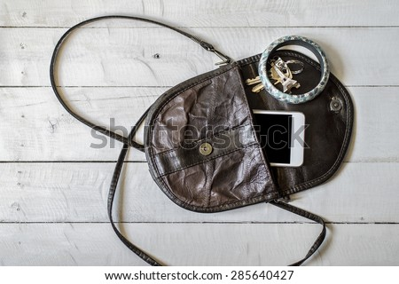 Brown women\'s purse. Things from open lady handbag.