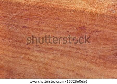 Brown wood background.Brown plank just sawed