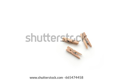 Brown wood clothes peg or clothespin on white background.