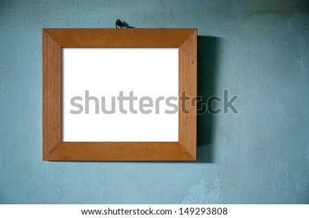 Brown Wood Photo Frame hang on Green old wall