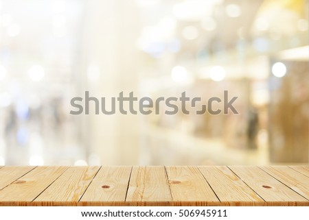 brown Wood table top with blurred office as background - can be used for montage or display your products Foto stock ©