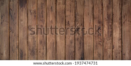 Brown wood texture background coming from natural tree. The wooden panel has a beautiful dark pattern, hardwood floor texture