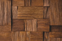 Brown wooden background made of different uneven square blocks textured