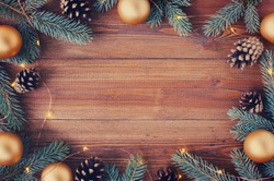 Brown wooden background with festive Christmas decoration, copy space