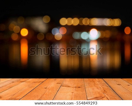 brown wooden board over blur bokeh background #554849293