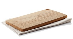 Brown wooden cutting board on cotton napkin isolated on white background. Clipping path
