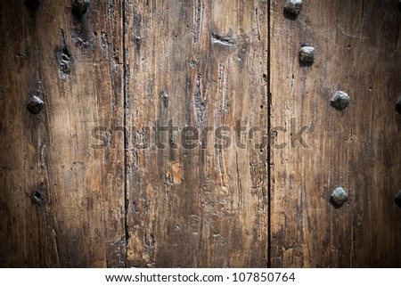 Brown wooden door background with nails