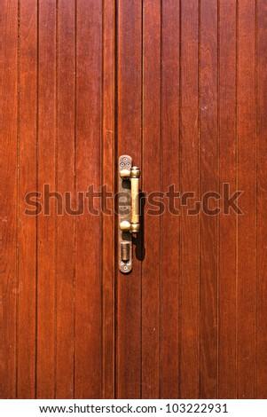 brown wooden door with brass handle - stock photo
