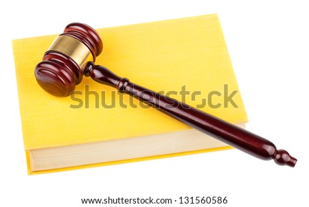 Brown wooden gavel and yellow book isolated on white background