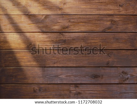 Photo of  brown wooden plank desk table background texture top view