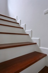 brown wooden stair and white wall in residential house