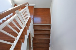 brown wooden stair interior decorated modern style of residential house