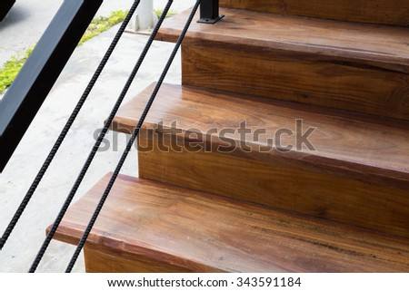 brown wooden staircase with iron banister in modern house