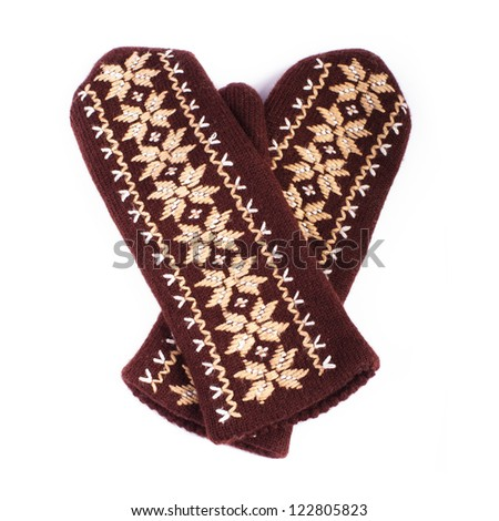 Brown woolen knitted mittens on white background #122805823